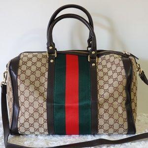 Gucci duffle 14 x 12 x 8